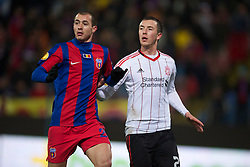 BUCHAREST, ROMANIA - Thursday, December 2, 2010: Liverpool's Danny Wilson and FC Steaua Bucuresti's Bogdan Stancu during the UEFA Europa League Group K match at the Stadionul Steaua. (Pic by: David Rawcliffe/Propaganda)