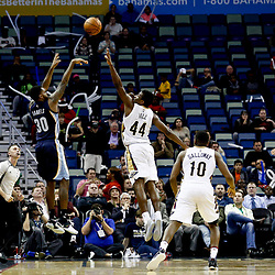 Dec 5, 2016; New Orleans, LA, USA; Memphis Grizzlies guard Troy Daniels (30) shoots over New Orleans Pelicans forward Solomon Hill (44) during overtime of a game at the Smoothie King Center. The Grizzlies defeated the Pelicans 110-108 in double overtime.  Mandatory Credit: Derick E. Hingle-USA TODAY Sports