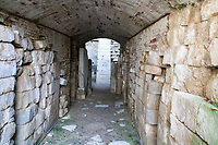 inside Etrurian grave in Italy,corridor with pillar at the end in chamber above cupol
