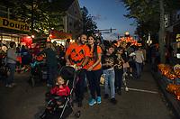 John Cardona, Susan Gutierrez and Samantha Cardona stroll down Main Street on Saturday evening with Pumpkin Fest in full swing.  (Karen Bobotas/for the Laconia Daily Sun)