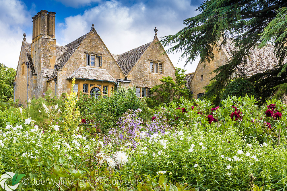 A border that includes dahlais, phlox and campanulas flourishes close to the house at Hidcote Manor Gardens, Gloucestershire.
