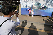Yeouido Island. A father photographs his kids in front of a poster showing the Tokdo islands claimed by South Korea in a dispute with Japan. Hundreds of Thousands of Seoulites enjoy the Cherry Blossom in Yunjungno, the street around the National Assembly lined by cherry trees which has been cleared from traffic for these days.