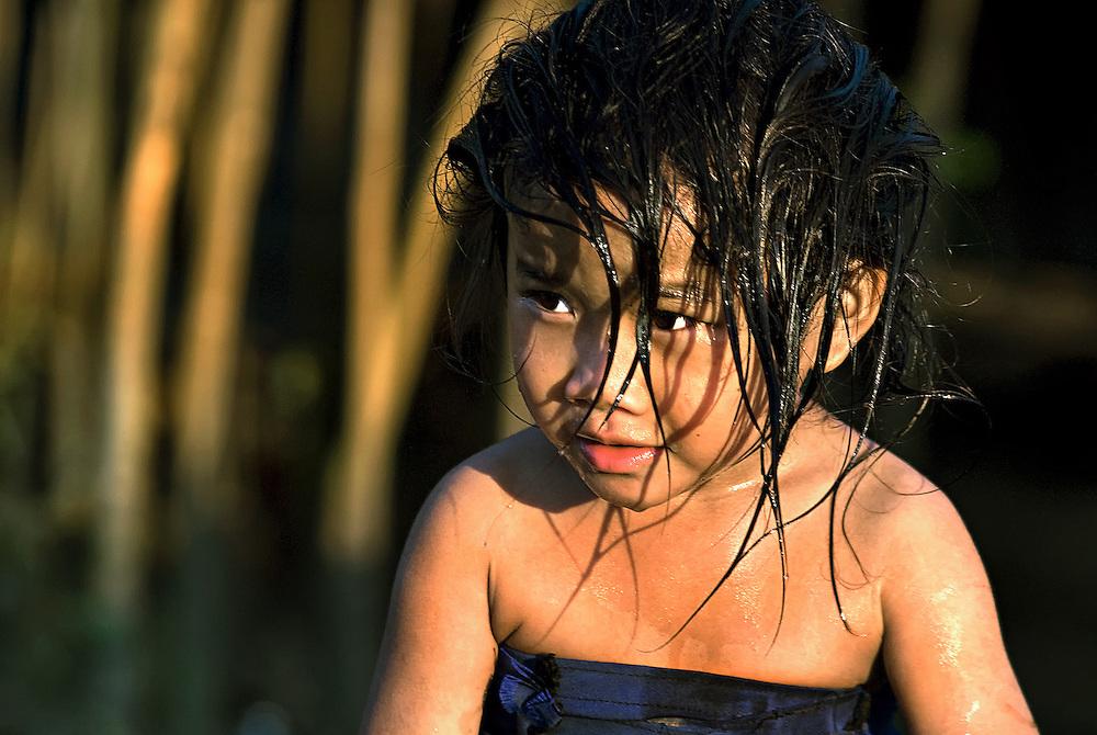 Bath time for a Hmong girl in Luang Namtha, Laos.