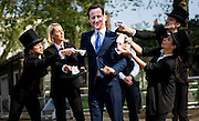 UNITED KINGDOM, London:  A flash mob is photographed featuring a man dressed as David Cameron surrounded by people dressed in top hats singing the Artful Dodgers song outside the anti-corruption summit to highlight corruption in companies in the UK, on May 12, 2016. Pic by Andrew Cowie / Story Picture Agency