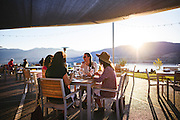 Wine and food with friends on a summer evening at Poplar Grove Winery, in Penticton, British Columbia