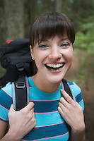 Woman wearing backpack smiling portrait