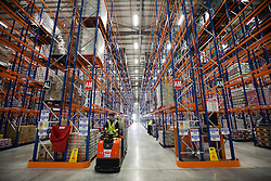© Licensed to London News Pictures. 25/06/2013. London, UK. Sainsbury's employees are seen at work in the supermarket chain's newest state of the art logistics centre in Charlton, London, today (25/06/2013). Officially opened today, the logistics centre is currently responsible for supplying around 90 supermarkets in the South East and has so far created 60 jobs on site, with another 1000 to follow in the next three years. Photo credit: Matt Cetti-Roberts/LNP