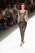 Perforated vinyl jumpsuit with sparkling trim. By Custo Barcelona at the Spring 2013 Fashion Week show in New York.