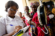 Nurse Christina Quarshey fills a chart to help track the growth of a child at the Osu Maternity Home in Accra, Ghana on Tuesday June 16, 2009.