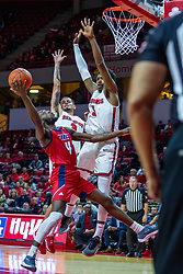 NORMAL, IL - December 18: Tarkus Ferguson shoots over Keith Fisher III and Ricky Torres during a college basketball game between the ISU Redbirds and the UIC Flames on December 18 2019 at Redbird Arena in Normal, IL. (Photo by Alan Look)