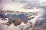 A glimpse of the Grand Canyon through the clouds captured in the middle of monsoon season after heavy rains.