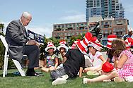 San Diego,CA - NEA Read Across America-NEA President Dennis Van Roekel reads to kids at PETCO Park Tuesday in San Diego,Ca. as part of the Read Across America program.( Photo/ Scott Iskowitz/ RA TODAY)