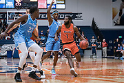 Cal State Fullerton Titans guard Brandon Kamga (1) is defended by San Diego Toreros guard Marion Humphrey (0) during an NCAA basketball game, Wednesday, Dec. 11, 2019, in Fullerton, Calif. San Diego defeated CSUF 66-54. (Jon Endow/Image of Sport)