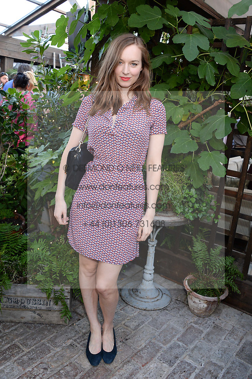 LOU HAYTER attending the Warner Bros. & Esquire Summer Party held at Shoreditch House, Ebor Street, London E1 on 18th July 2013.