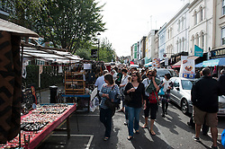 © London News Pictures. 30/08/2014. London, UK. Portobello Road in West London today (30/08/2014). A murder investigation has been launched after a Man aged in his fifties died of stab wounds in the early hours of this morning on Portobello Raod. Respect party politician George Galloway was alleged assaulted in the same area late yesterday evening. Photo credit : Ben Cawthra/LNP