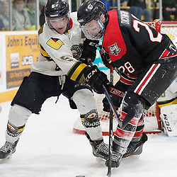 TRENTON, ON  - MAY 5,  2017: Canadian Junior Hockey League, Central Canadian Jr. &quot;A&quot; Championship. The Dudley Hewitt Cup. Game 7 between The Georgetown Raiders and The Powassan Voodoos. Eric Nagy #5 of the Powassan Voodoos and Josh Dickinson #28 of the Georgetown Raiders battle for the puck during the second period. <br /> (Photo by Amy Deroche / OJHL Images)