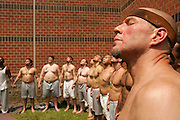 During a monthly Native American Sweat Lodge at a prison, inmates stand in a circle and pray. Any prisoner who wishes to can participate.
