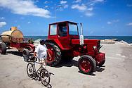 Tractor hauling water in Puerto Padre, Las Tunas, Cuba.