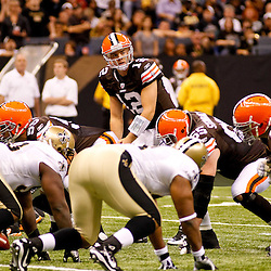 Oct 24, 2010; New Orleans, LA, USA; Cleveland Browns quarterback Colt McCoy (12) under center during the first half against the New Orleans Saints at the Louisiana Superdome. Mandatory Credit: Derick E. Hingle
