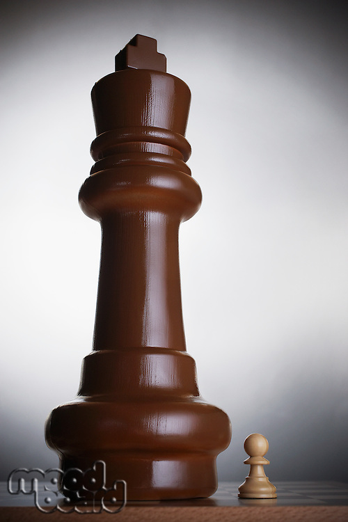 Two chess pieces large king and small pawn