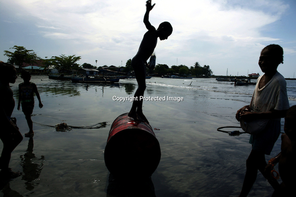 "A child plays with an empty fuel barrel at the beach in Sarmi, West Papua. In the Sarmi region of Papua , attempts from national and foreign companies to buy the rainforest have been turned down by Sarmi's govenor. (Logging is one of the major causes of destruction in West Papua). He thinks it's not a solution to destroy Papua's rainforest and replace it with oil palm plantations as those take about eight years to grow until the first harvest. He rather encourages Indonesians from other islands like Java and Sumatra to move to Papua and find jobs in the fishing industry or settle in the rainforest. Should the government ever try to allow companies to explore the rainforest in Sarmi , there'd ""be trouble"" with the locals. Sarmi is seen as a positive alternative to the destruction of the rainforest in other parts of Papua . <br /> Photo by @hessekatharina #newguinea #papua #climatechange #climatechangeisreal #logging"