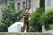 """A North Korean woman soldier on a dock in the river port town of Sinuiju July 8, 2006. China and North Korea are separated by the Yalu River, upon which Chinese tourists take pleaure cruises across the water to  observe their less economically developed neighbors.  North Korea has threatened to take """"stronger physical actions"""" after Japan imposed punitive measures in response to its barrage of missile tests and pushed for international sanctions. North Korea has vowed to carry out more launches and has said it will use force if the international community tries to stop it. DPRK, north korea, china, dandong, border, liaoning, democratic, people's, rebiblic, of, korea, nuclear, test, rice, japan, arms, race, weapons, stalinist, communist, kin jong il"""