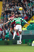 14th October 2017, Celtic Park, Glasgow, Scotland; Scottish Premiership football, Celtic versus Dundee; Dundee's Lewis Spence competes in the air with Celtic's Olivier Ntcham