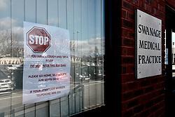 Warning sign outside Swanage Medical Practice during Coronavirus lock down, Swanage, Dorset UK April 2020
