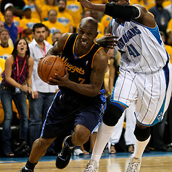 25 April 2009: Denver Nuggets guard Chauncey Billups (7) drives by New Orleans Hornets forward James Posey (41) during a 95-93 win by the New Orleans Hornets over the Denver Nuggets in game three of the NBA Western Conference quarter-finals playoff at the New Orleans Arena in New Orleans, Louisiana.
