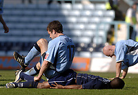 Photo. Glyn Thomas. <br /> Coventry City v Brighton and Hove Albion. <br /> Coca Cola Championship. 02/04/2005.<br /> Coventry's Michael Doyle (L) sits on top of Brighton's Leon Knight (C) in retaliation after Knight appeared to foul Coventry's Robert Page.