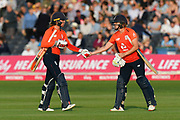 Lauren Winfield of England and Katherine Brunt of England shake hands as they walk off after finishing the England innings with a total of 139 for 5 during the 3rd Vitality International T20 match between England Women Cricket and Australia Women at the Bristol County Ground, Bristol, United Kingdom on 31 July 2019.