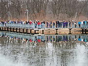 08 DECEMBER 2019 - CORALVILLE, IOWA: People wait in line on a walkway built over a wetland area in Corralville, Iowa, to hear Mayor Pete Buttigied speak Sunday. Hundreds of came to Buttigieg's campaign event. Buttigieg, the mayor of South Bend, Indiana, is running to be the Democratic nominee for President in the 2020 election. Iowa traditionally holds the first presidential selection event of the 2020 election cycle. The Iowa Caucuses are on Feb. 3, 2020.   PHOTO BY JACK KURTZ