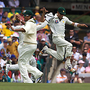 Umar Gul (right) celebrates after catching Ricky Ponting out for a first ball duck off the bowling of Mohammed Sami during the Australia V Pakistan 2nd Cricket Test match at the Sydney Cricket Ground, Sydney, Australia, 3 January 2010. Photo Tim Clayton