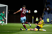 Albian Ajeti (27) of West Ham United crosses the ball and is challenged by Elliott Moore (5) of Oxford United during the EFL Cup match between Oxford United and West Ham United at the Kassam Stadium, Oxford, England on 25 September 2019.
