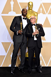 March 4, 2018 - Los Angeles, California, USA - 3/4/18.Kobe Bryant and Glen Keane winners of the award for Best Animated Short Film for ''Dear Basketball'' at the 90th Annual Academy Awards (Oscars) presented by the Academy of Motion Picture Arts and Sciences..(Hollywood, CA, USA) (Credit Image: © Starmax/Newscom via ZUMA Press)