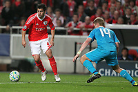 Benfica's forward Nolito tries to pass trough Zenit's defender Tomas Hubocan durig the UEFA Champions League football match between Benfica and Zenit at Luz Stadium in Lisbon on March 06, 2012.  Carlos Rodrigues