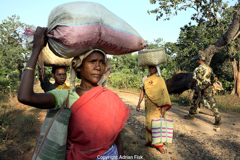 Tribal women stand still as a patrol made up of police and Salwa Judam militia pass them by in Dantewada district.<br /> The relationship between the local tribals and the state remains a tense one.