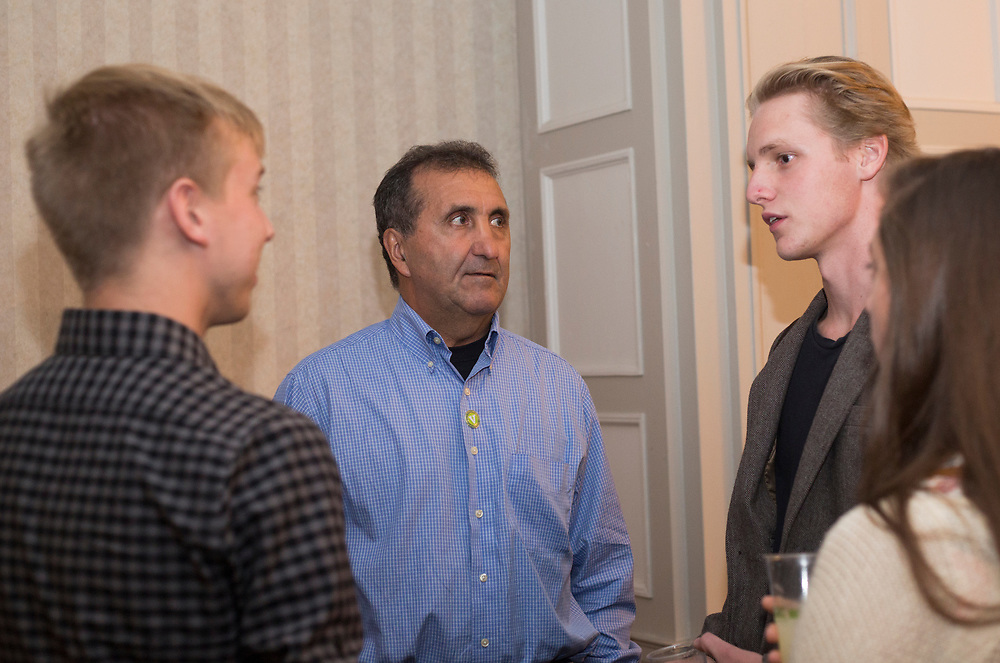 Pete Souza talks with from left, Patrick Connolly, a senior studying photojournalism, Michael Swensen, a junior studying photojournalism, and Kelsey Brunner, a second year graduate student studying photojournalism, before the start of the President's Reception in Chaddock Alumni Room on September 19, 2017.