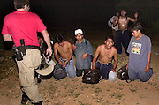 A group of undocumented migrants from Mexico surrenders to BORSTAR agents at Little Tucson on the Tohono O'odham Nation, Arizona, USA.  The group reported that they left three others behind, including a 55-year-old uncle who died from heat exhaustion and dehydration.  The smuggler abandoned them when some became ill.