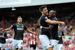 Charlton players congratulate Igor Vetokele on his goal - Photo mandatory by-line: Patrick Khachfe/JMP - Mobile: 07966 386802 09/08/2014 - SPORT - FOOTBALL - Brentford - Griffin Park - Brentford v Charlton Athletic - Sky Bet Championship - First game of the season