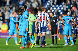 Paulinho (BRA) of Tottenham Hotspur and Emmanuel Adebayor (TOG) of Tottenham Hotspur look dejected after they can only manage a 3-3 draw - Photo mandatory by-line: Rogan Thomson/JMP - 07966 386802 - 12/04/2014 - SPORT - FOOTBALL - The Hawthorns Stadium - West Bromwich Albion v Tottenham Hotspur - Barclays Premier League.