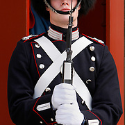 Change of the guard at Amalienborg, the winter home of the Danish Royal Family, located in Copenhagen's Frederiksstaden district. It consists of four identical palace façades with rococo interiors around an octagonal courtyard.<br /> Photography by Jose More