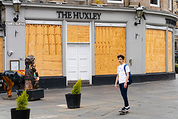 Edinburgh, Scotland, UK. 17 June, 2020. Views from Edinburgh city centre before expected relaxation of covid-19 lockdown by Scottish Government. Pictured; The Huxley bar and restaurant remains closed and boarded up. Iain Masterton/Alamy Live News