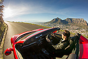 Ecurie25 super car club launching in South Africa. Images of Ferrari 458 Spyder and Maserati Gran Cabrio Sport taken in front of Table Mountain, Cape Town by photographer Greg Beadle