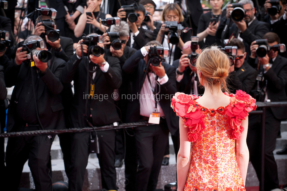 Actress and model Clemence Poesy with photographers at the Closing Palm D'Or Awards Ceremony at the 69th Cannes Film Festival, Sunday 22nd May 2016, Cannes, France. Photography: Doreen Kennedy