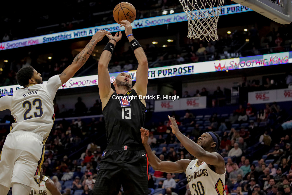 Dec 3, 2018; New Orleans, LA, USA; New Orleans Pelicans forward Anthony Davis (23) knocks the ball from LA Clippers center Marcin Gortat (13) as forward Julius Randle (30) defends during the second quarter at the Smoothie King Center. Mandatory Credit: Derick E. Hingle-USA TODAY Sports