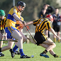"""Jamie Shanahan Sixmilebridge battles for possession with Ballyea's Jack Browne durng the Minor """"A"""" Hurling Final.<br /> Photograph by Flann Howard"""