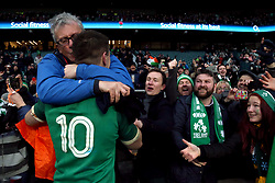 Ireland's Johnny Sexton celebrates with his godfather Billy Keane after winning the Grand Slam in the NatWest 6 Nations match at Twickenham Stadium, London