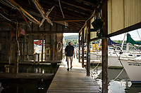 Merrill Fay walks out on the dock that he built in 1963 at Fay's Boat Yard on Lake Winnipesaukee.  (Karen Bobotas/for New England Boating)