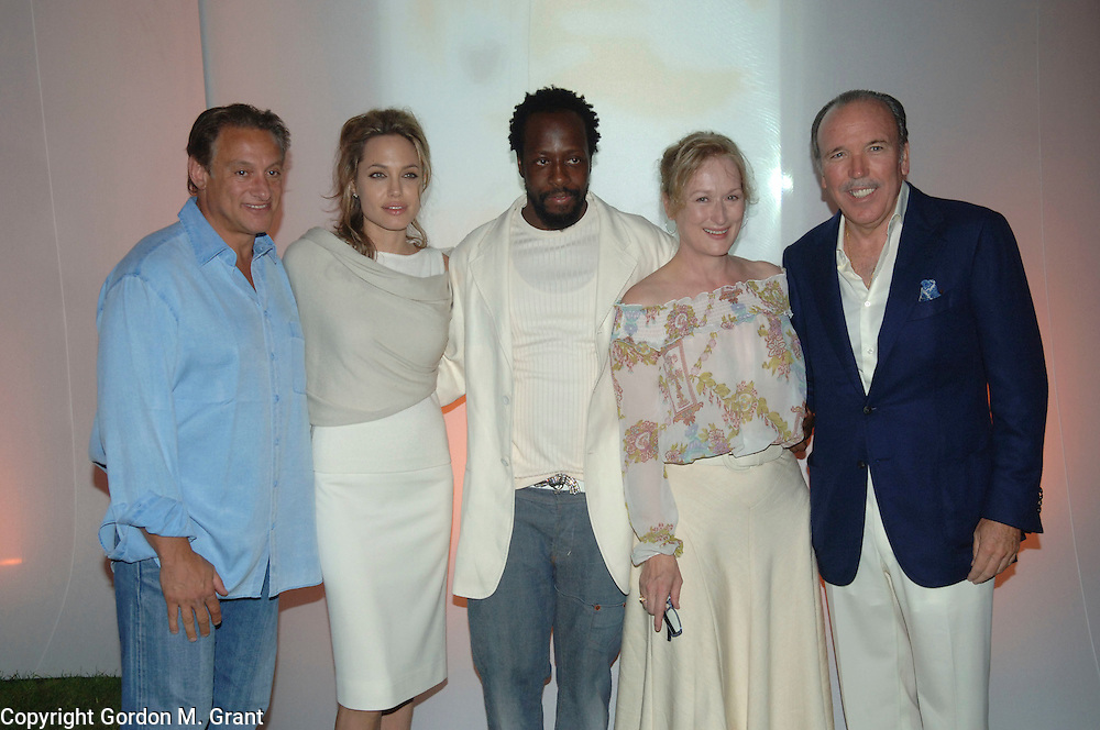 Wainscott, NY - 8/27/05 -  Cary Woods, Angelina Jolie, Wyclef Jean, Meryl Streep and Pepe Fanjul at the Yele Haiti, Haitian Relief Benefit at the home of Cary Woods and Andrea Kerzner in Wainscott, NY August 27, 2005.    (Photo by Gordon M. Grant / Zuma Press)<br />